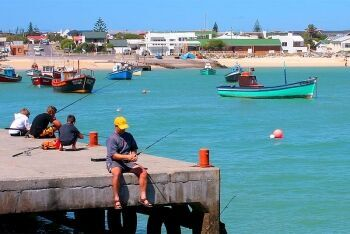 Fishing in the picturesque harbour at Struisbaai, Whale Coast, Western Cape